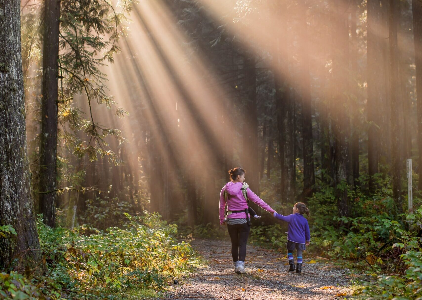 Women and daughter exploring the forest