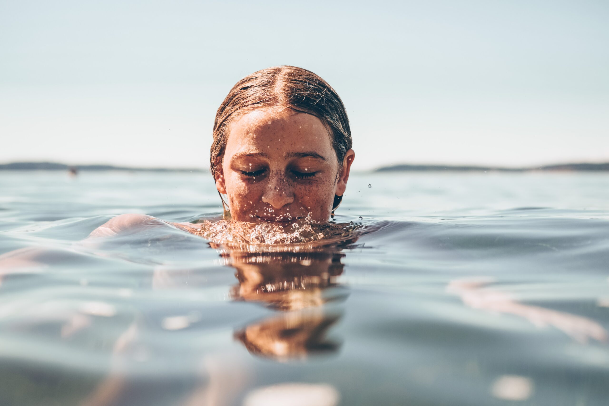 woman swimming in deep water